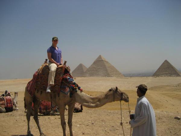 Take a camel ride around the pyramids.