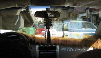 typical taxi in Cairo - note the Quran on the dash