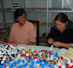 Locals making masapan figurines in Calderon