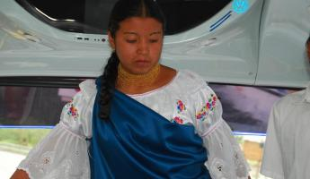 Young lady explaining the traditional dress of Ecuador.