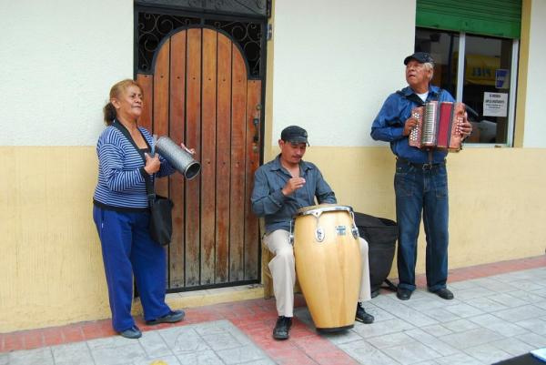 Locals in Cotacachi serenading the tourists
