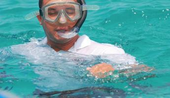 Luis snorkeling in the crystal blue waters of the Galapagos