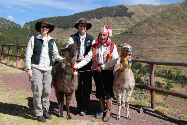 Us, and a peruvian native with his llamas near Pisac, Peru