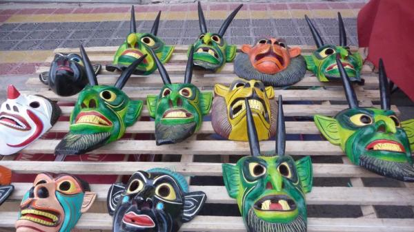 Celebration masks at the Otavalo market