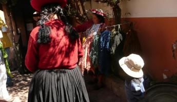 Ladies demonstrating how wool is dyed