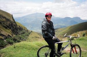 Ecuador traveler enjoying the view on a biking tour