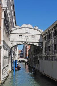 Take a gondola down the canals of Venice, Italy