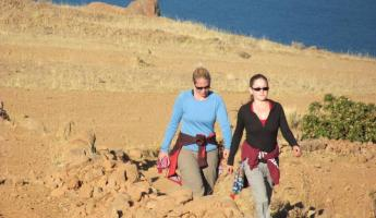 Kassi and Ashley hiking on Amantani Island