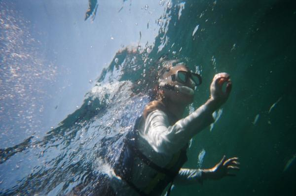 Traveler on a snorkeling trip in the Galapagos Islands