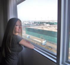 Ashley looks over the Lima airport from our hotel room
