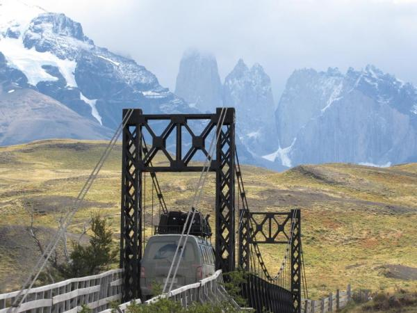 Crossing a suspension bridge in to Torres del Paine National Park