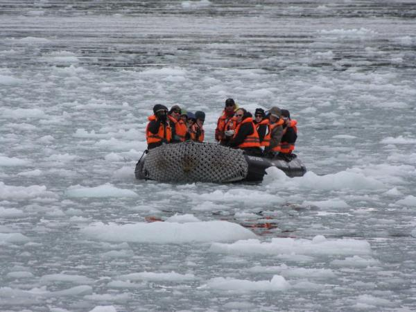 One of our Zodiacs in icy waters (Pia Glacier)