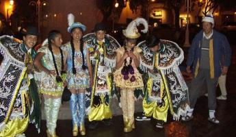 Walking in Cusco at night, dancers dressed in their finest.