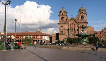 Relax in the bustling Cusco plaza and watch the people go by during your Peru travels