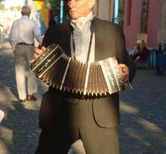 A man plays in the street