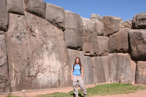 Pose by the massive stones of Sacsayhuaman on your Peru travels