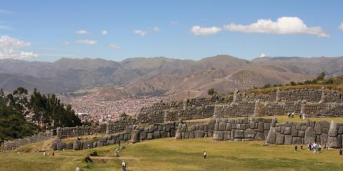 Get a birds eye view of the walls of Sacsayhuaman and the red roofs of Cusco on your travels to Peru