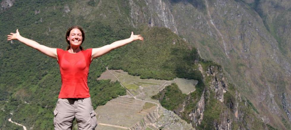 Take a victory picture from the top of Huayna Picchu on your Peru tour