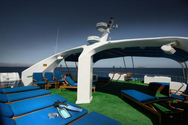 Ample sun deck spaces to relax on board the Galapagos Sky