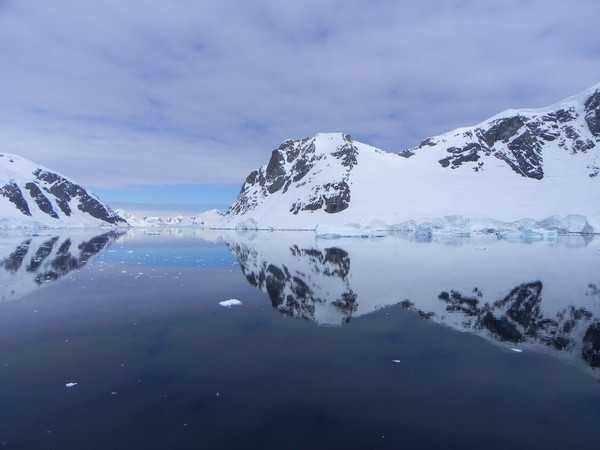 Prestine glass reflection on the waters of Antarctica