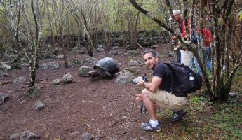 getting up  close and personal with a tortoise. they were awesome creatures.