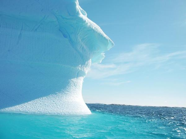 Cruising around a brilliant blue iceberg on an Antarctica adventure