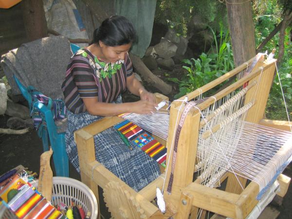 Watching a Maya woman weaving on Guatemala tour