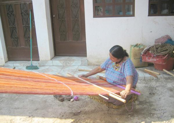 Maya woman weaving on Guatemala tour