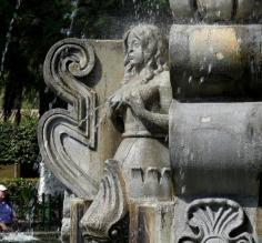 Unusual mermaids on fountain in center of park