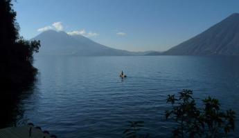 Paddling a cayuco, the traditional Lago Atitlan boat used by locals for fishing and crabbing