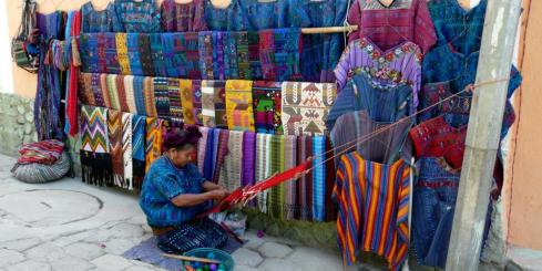 A local woman weaves beatiful textiles in Guatemala
