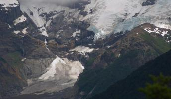 Tronador glaciers. Clean ice upside and black at bottom