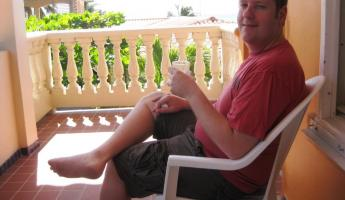 Ryan enjoying a lazy balcony breakfast