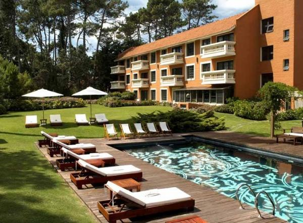 Relax by the pool during your stay at Barradas Parque Hotel
