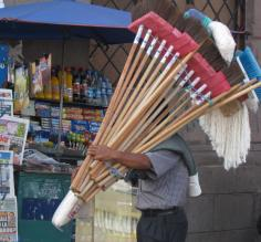 A street vendor peddles brooms in downtown Quito