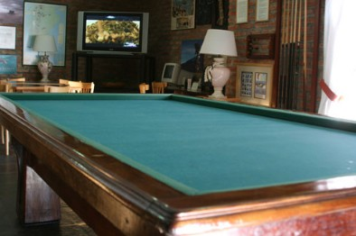 Guests enjoy the use of the pool table, flat screen TV, video library and more
