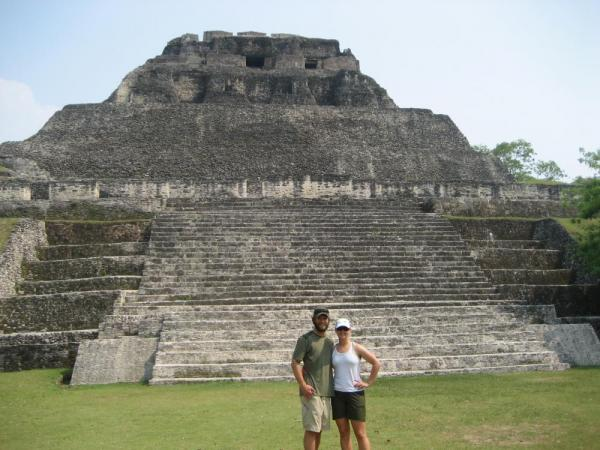 A couple prepares to climb El Castillo at Xunantunich Ruins