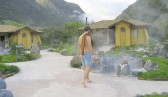 A traveler approaches the private thermal pools at Papallacta for a hot soak during his Ecuador vacation