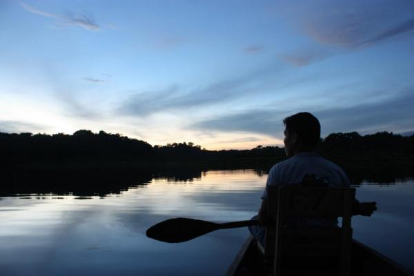 Soak in the Amazon from your night-time canoe explorations