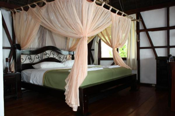 Luxury accommodations include a king and a twin bed in each cabana