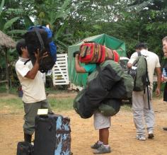 The super hero porters taking our bags to the river to head into Tambopata.