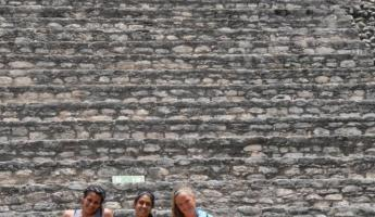 Girls on steps of Caracol Mayan Temple, Queens tomb