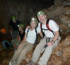 All smiles exploring a cave in the Belizean jungle