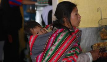 Cusco, Peru: Mother & child in market