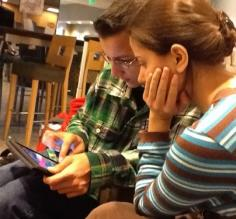 the kids on break playing a game on the iPad