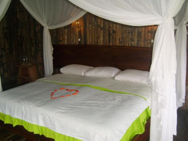 All cabins include fully screened sleeping area, mosquito nets and private bath facilites