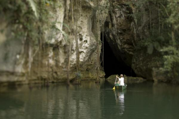 Canoeing into Barton Creek cave