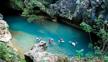 Tubing on the Caves Branch River system in Belize