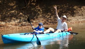 Family kayaking while staying at the Lodge at Big Falls