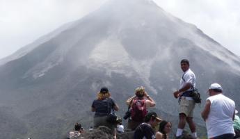 Admiring the massive Arenal Volcano in Costa Rica